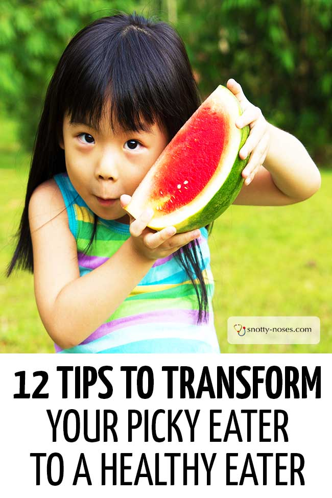 A little girl holding up a watermelon. #pickyeater #fussytoddler #fussyeaters #parents #parenthood #parentlife #lifewithkids