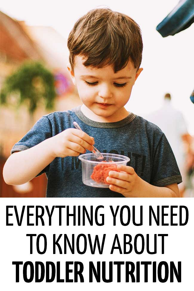A toddler eating a portion of healthy ice cream in a plastic cup. Everything you need to know about toddler nutrition!
