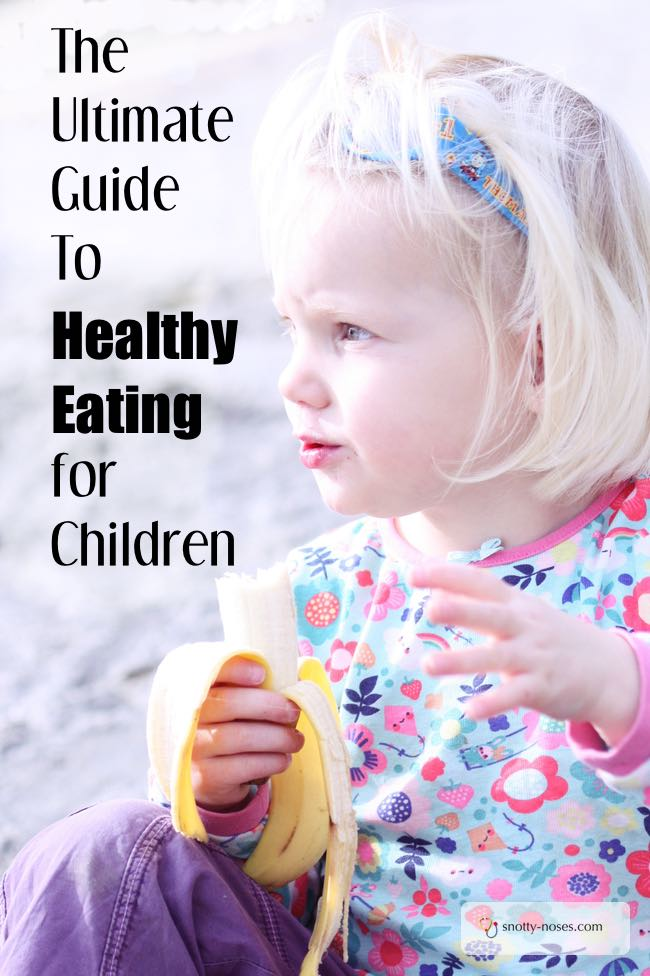 A child eating a banana. Healthy Meals for Children