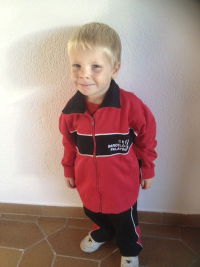 A boy in a school track suit