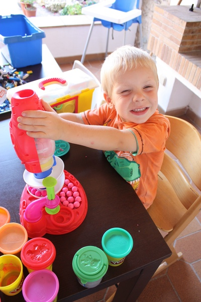 A boy playing with playdoh