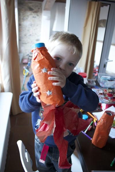 Boy holding a home made rocket