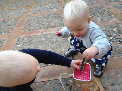 Babies playing with a toy