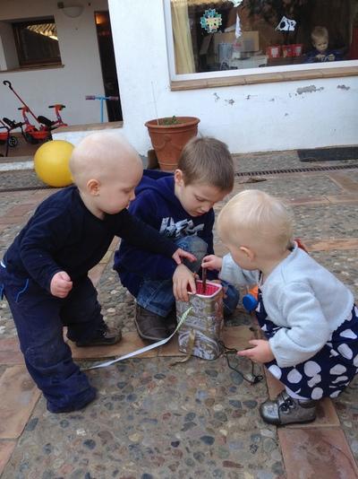 Children examining a toy